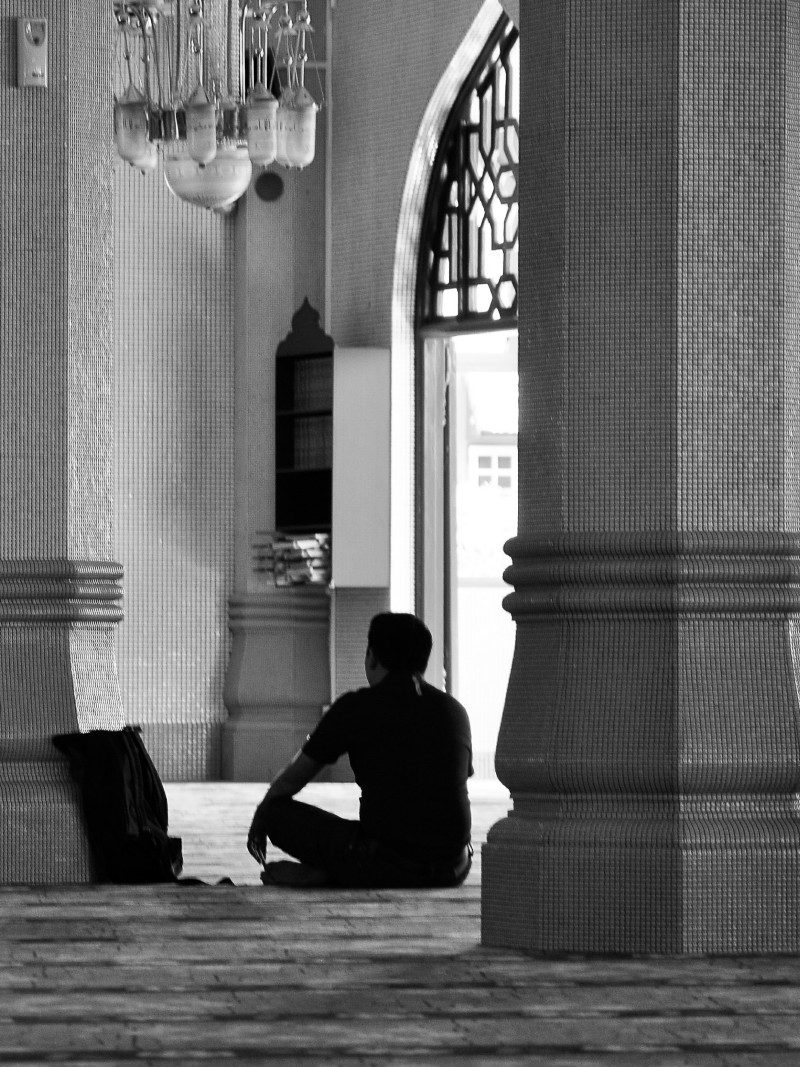 A man in a mosque bw